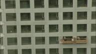MS HA ZI Window washers on platforms, Beijing, China