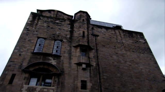 Windows and an arch over a window adorn a section of the Glasgow School of Art, Scotland. Available in HD.