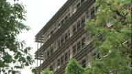 Windows line the facade of the Saitama Prefectural Police Office in Japan.