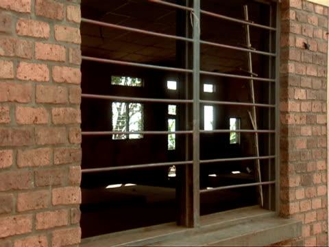 MS Windows of abandoned mayor building / Taba, Gitarama, Rwanda