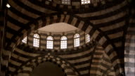 Windows pierce the domed ceiling of the Khan As'ad Pasha in Damascus. Available in HD.