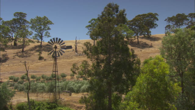 A windpump turns in the Australian countryside.