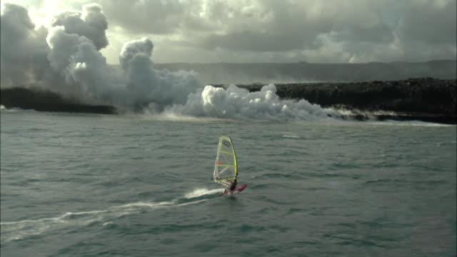 AERIAL WS TS Windsurfer and smoking volcano, Hilo, Hawaii, USA