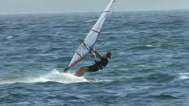 HD: Windsurfer  in the sea (slow motion)