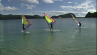 Windsurfers sail on the Pacific Ocean off Chichijima Island in Japan.