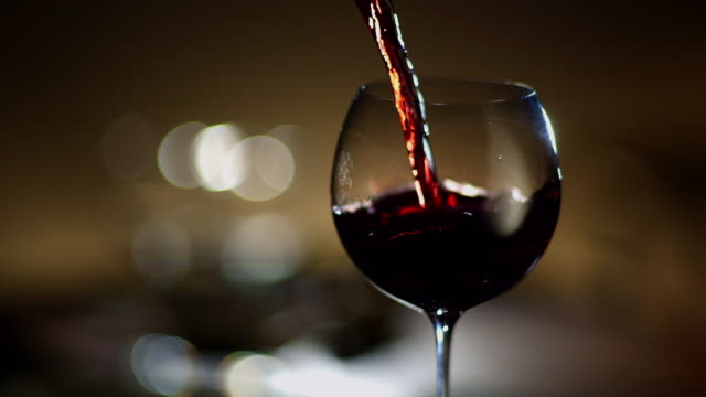 CU Wine being poured into wine glass
