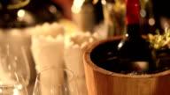 wine bottle in wood bucket