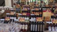 PAN / Wine bottles in delicatessen shop
