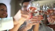Winetasting and toasting.