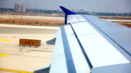 Wing of the plane on Runway