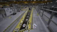 A wing stands in a bay on the Airbus SE A350 wing production line at the Airbus SE assembly factory in Broughton UK on Monday Jan 16 An employee...