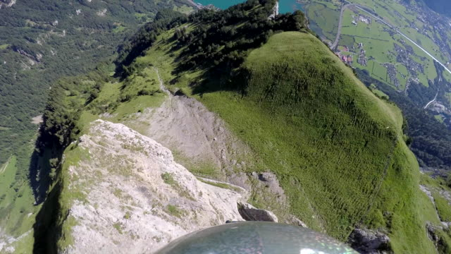 Wingsuit POV jumping off cliff and flying