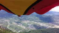 POV of wingsuit pilot flying through valley