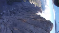 POV of wingsuit pilots jumping off cliff