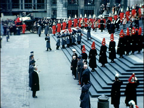 Winston Churchill State Funeral Close shots of crowd Coffin of Sir Winston Churchill carried down steps from St Paul's Cathedral / Harold MacMillan...