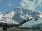 Winter Driving Through Snow Covered Mountain Range