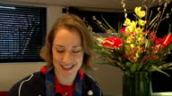 Team GB arrive back at Heathrow / Lizzy Yarnold interview Lizzy Yarnold SOT / CU Gold medal