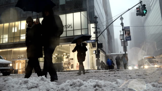 Winter storm Stella hits the Northeast of the United States / 5th Avenue 42nd Street Midtown Manhattan New York City USA