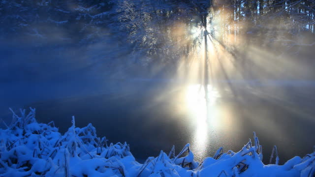 winter sunbeam on a small lake