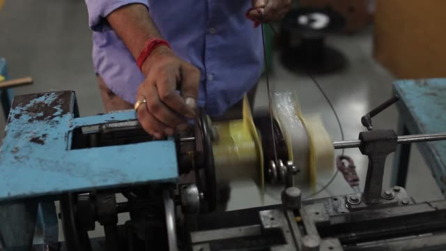 MCU wire is coiled around a magnetic core on the assembly line of the SuKam Power Systems Ltd factory in Gurgaon India on Tuesday June 7 Workers...