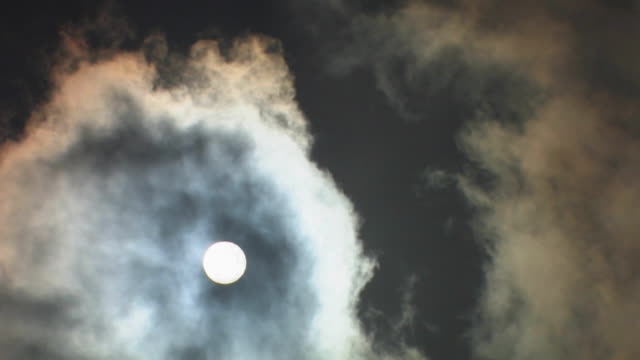 T/L, WS, Wispy clouds covering full moon, Laikipia, Kenya