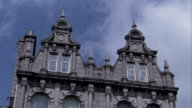 Wispy clouds float above an ornate portion of Marischal College in Aberdeen, Scotland. Available in HD.