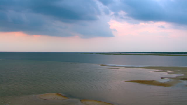 Wispy clouds float above the calm waters at Gulf Islands National Seashore in Mississippi.