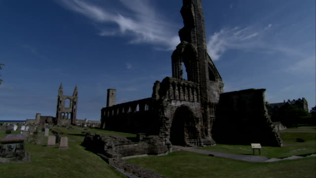 Wispy clouds hover over the ruins of St Andrews Cathedral. Available in HD.