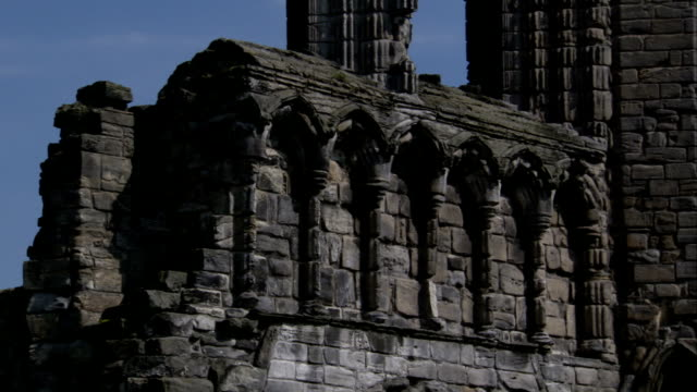 Wispy clouds hover over the ruins of the nave at St Andrews Cathedral. Available in HD.