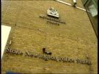 Girl continues with evidence ENGLAND London Stoke Newington Stoke Newington Police Station LA GV police station windows PAN
