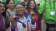 With a jaunty victory dance 101yearold Man Kaur celebrates winning the 100 metres sprint at the World Masters Games in Auckland the 17th gold medal...