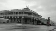 With cars up and past on a grey wet day The White Hart Hotel according to Architecture Now is and isn't your typical Kiwi hotel Built in 1886 it is a...