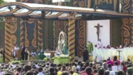 With chants in Latin and Guarani Pope Francis leads a huge open air mass Sunday in Asuncion with strong references to Paraguayan culture hours before...