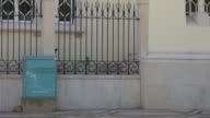 With man cleaning railings and people walking to and fro This landmark is next to the Church of Mercy in the Praça Dom Francisco Gomes The building...