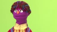 With purple skin and an orange nose her multicoloured braids wrapped in a headscarf Zari is Sesame Street's first female Afghan muppet and she has a...
