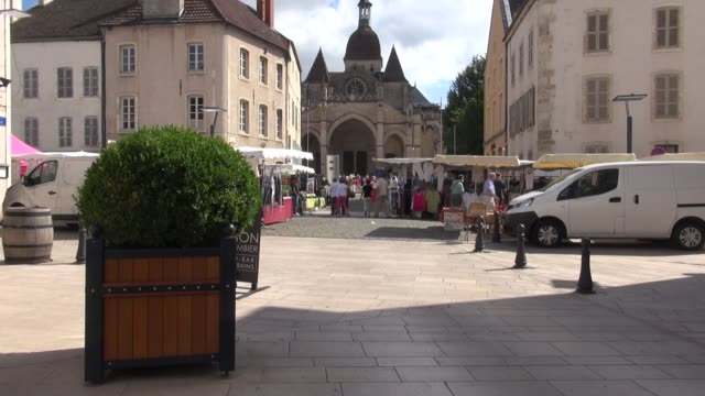 With the Basilique NotreDame de Beaune in background The area is famous for its wines and also on sale in the market arre truffles and Poulet de...