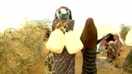 with their heads at refugee camp Women carrying gallons of water on July 30 2011 in Dadaab Kenya