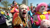 With their red noses oversized pants and silly antics more than 300 clowns from across Latin America made a collective attempt in Mexico City to set...