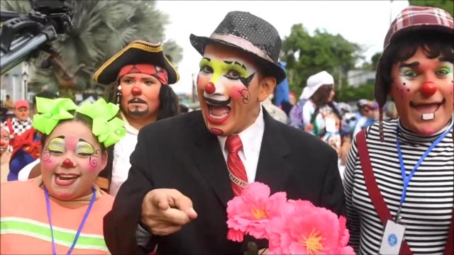 With wide smiles and full of fun professional clowns from across Central America participate in a parade to exchange magic tricks and good humour as...