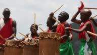 With wild dancing to a furious beat booming wooden drums echo over a hill in Burundi are an ancient sound from a sacred tradition once a symbol of...