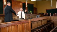 Witness taking oath in Courthouse with Judge (Law)