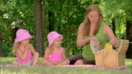 Woman and girls picnicking