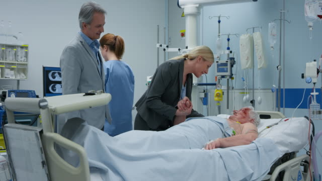 DS Woman and her husband visiting her father in the ICU