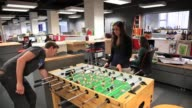 Woman and man play foosball in entrepreneurial office space