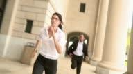 SLO MO POV Woman and man running along colonnade, Jacksonville, Florida, USA