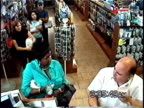HA WS Woman arguing with senior man in convenience store while other customers wait in line in behind him / Brooklyn, New York, USA