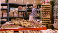 MS, PAN, Woman arranging boxes in shop of homemade soap, Haverstraw, New York State, USA