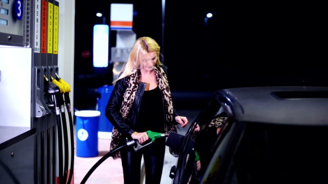 Woman at gas station