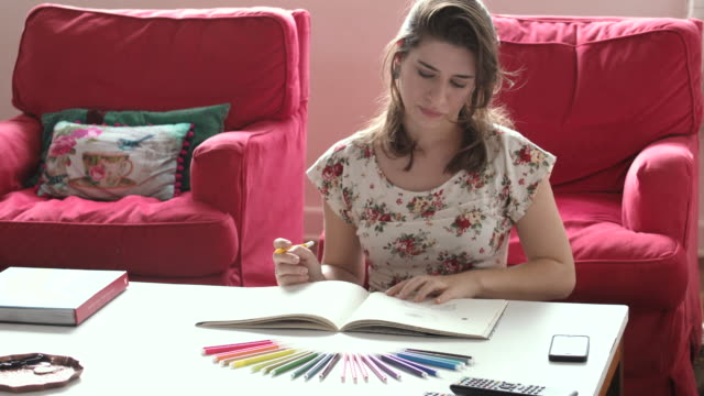 Woman at home with coloring book