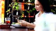 Woman at lunch break sitting in outdoor restaurant bar